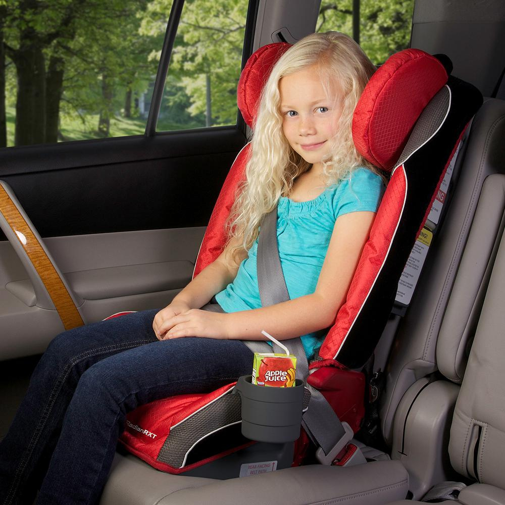 blond child in booster seat