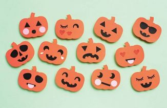 paper craft pumpkins all with different facial expressions