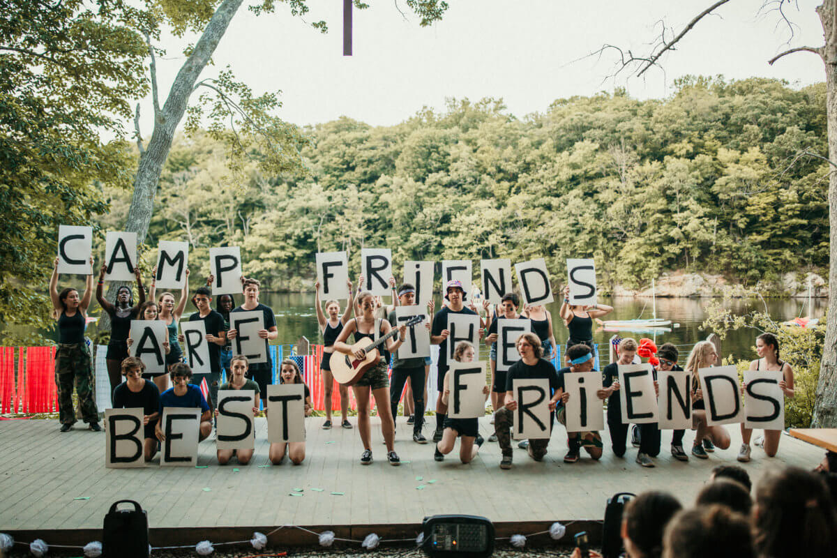 kids-holding-up-letter-signs-at-camp.jpg