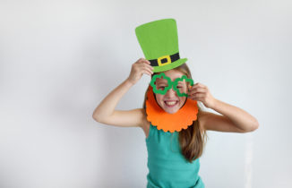 young girl dressing up for St. Patrick's Day