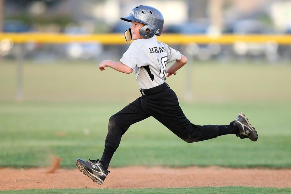 baseball kid running
